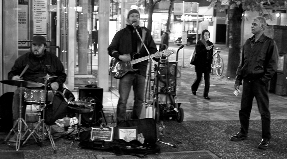 "From the corner of Robson St. and Granville St. Vancouver while Street Band is Playing ""All Along The Watchtower"". November 2014."